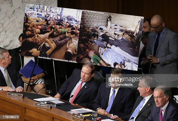 S Senators view photographs of victims of chemical weapons attacks in Syria as US Secretary of State John Kerry US Defense Secretary Chuck Hagel and...