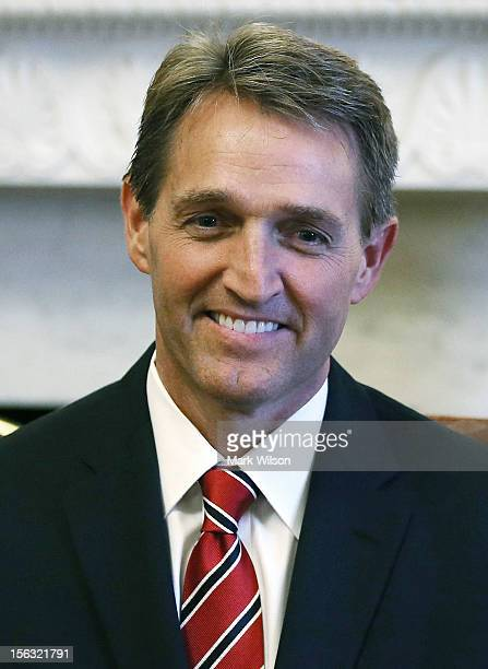 GOP senatorselect Jeff Flake poses for a picture with Senate Minority Leader Mitch McConnell at the US Capitol on November 13 2012 in Washington DC...