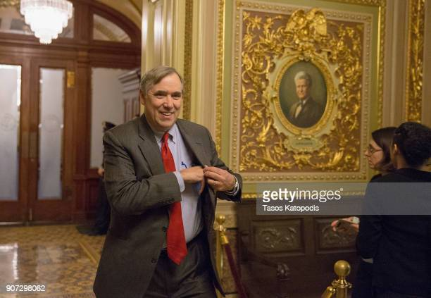Senatot Jeff Merkley walks to a Democratic Caucus meeting at the US Capitol on January 19 2018 in Washington DC A continuing resolution to fund the...
