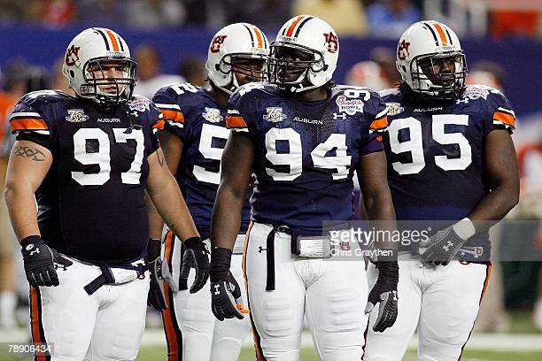 Sen'Derrick Marks of the Auburn University Tigers and teammates Pat Sims and Josh Thompson wait during the game against the Clemson Univeristy Tigers...