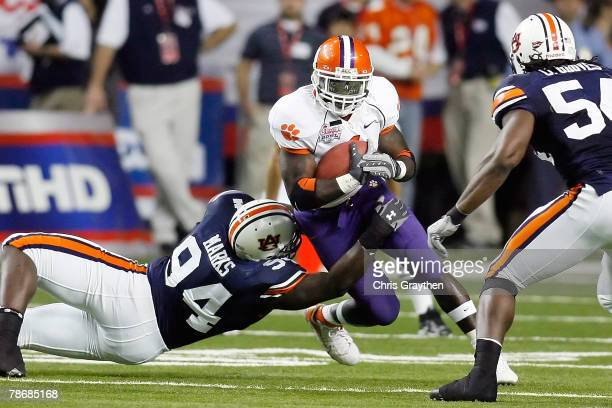 Sen'Derrick Marks of the Auburn University Tigers tackles James Davis of the Clemson University Tigers during the ChickFilA Bowl on December 31 2007...