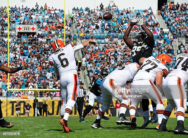 Sen'Derrick Marks of the Jacksonville Jaguars bats down a pass by Brian Hoyer of the Cleveland Browns at EverBank Field on October 19 2014 in...