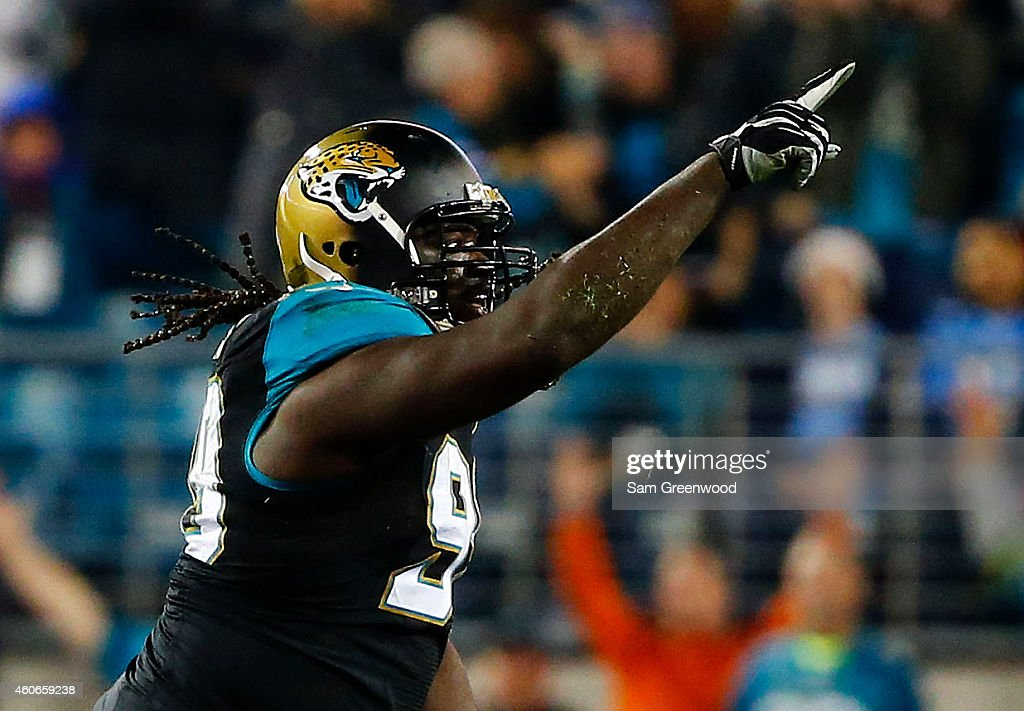 Sen'Derrick Marks #99 of the Jacksonville Jaguars celebrates a sack in the fourth quarter against the Tennessee Titans at EverBank Field on December 18, 2014 in Jacksonville, Florida.