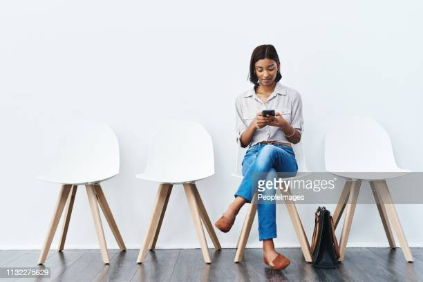 sending a quick text before i go for the interview - waiting room stock pictures, royalty-free photos & images