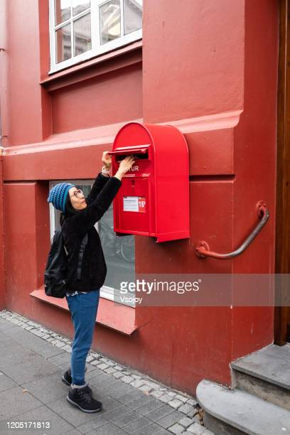 sending postcards, reykjavik, iceland - postcard stock pictures, royalty-free photos & images