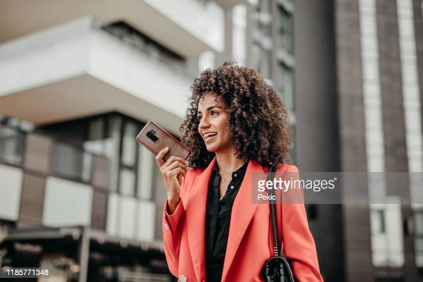 sending voice messages on the move - speech recognition stock pictures, royalty-free photos & images