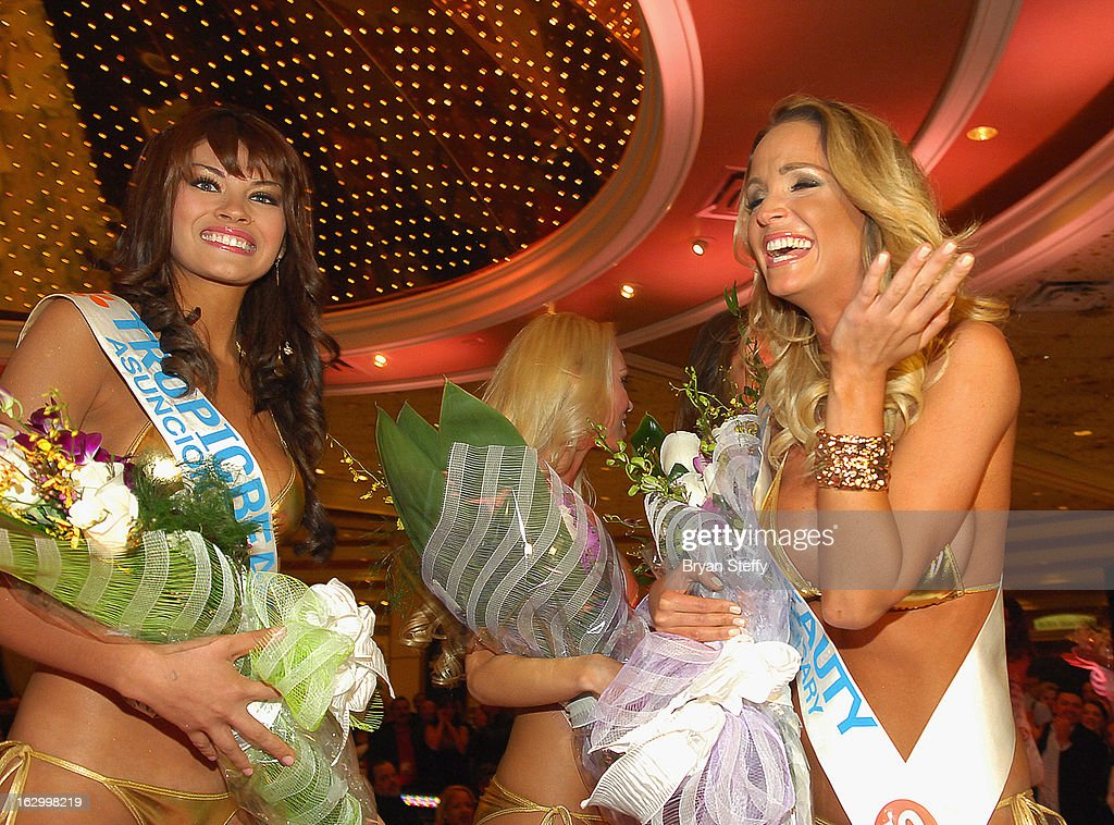 Sendy Caceres of Paraguay (L) appears with Linda Zimany of Hungary as she is named Miss TropicBeauty 2013 during the third annual TropicBeauty World Finals at the MGM Grand Hotel/Casino on March 2, 2013 in Las Vegas, Nevada.