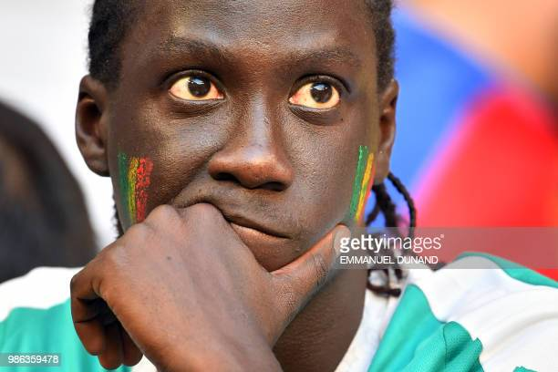 Senegal fan reacts at the end of the Russia 2018 World Cup Group H football match between Senegal and Colombia at the Samara Arena in Samara on June...