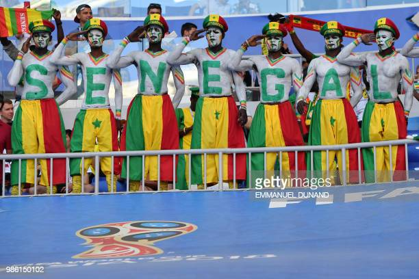 TOPSHOT Senegal fans cheer before the start of the Russia 2018 World Cup Group H football match between Senegal and Colombia at the Samara Arena in...