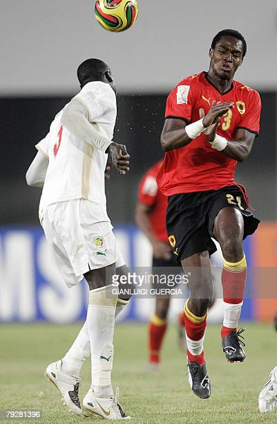 TEAM Senegal forward Maleus Alberto 'Manucho' and Angola's defender Guirame Ndaw fight for the ball 27 January 2008 during the 2008 African Cup of...
