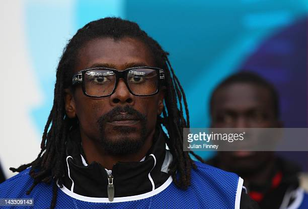 Senegal interim coach Aliou Cisse looks on during the London 2012 Olympic Qualifier match between Senegal and Oman at the Ricoh Arena on April 23...