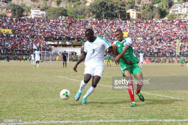 Senegal Kalidou Koulibaly and Madagascar captain Andriatsima Fanev Ima vie for the ball during their Africa Cup of Nations 2019 qualifier on...