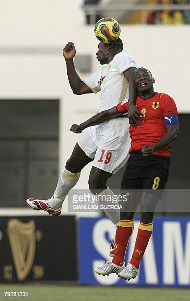 Senegal midfielder Pape Bouba Diop and Angolan midfielder Andre Macanga jump for the ball 27 January 2008 during the 2008 African Cup of Nations...