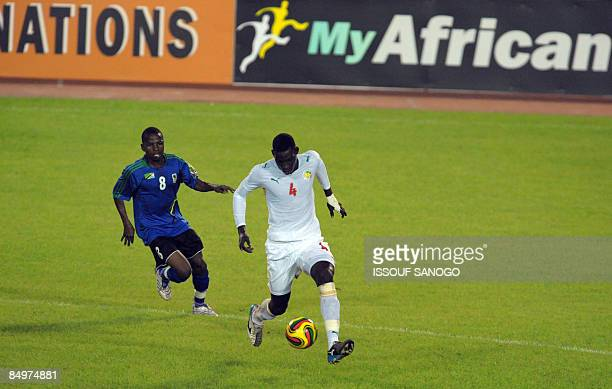 Senegal National football team captain Sidy Ndiaye fights for the ball with Tanzania National football team player Alfani Ngasa at the Felix...
