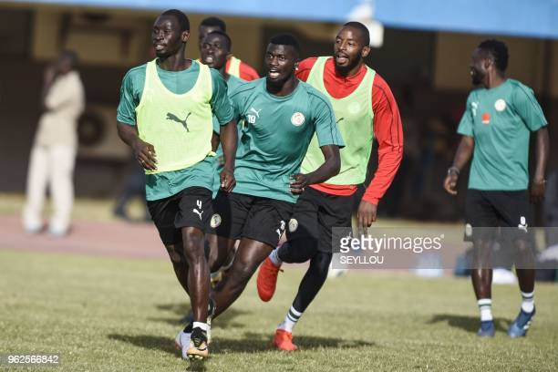 Senegal national football team's defender Saliou Ciss and goalkeeper Abdoulaye Diallo take part in a training session at the Leopold Sedar Senghor...