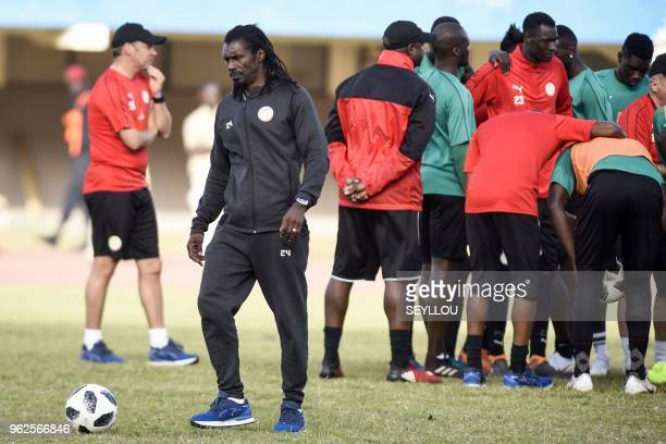 Senegal national football team's head coach Aliou Cisse attends a training session at the Leopold Sedar Senghor stadium in Dakar on May 25 before...