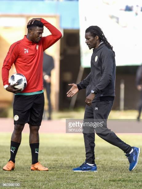 Senegal national football team's head coach Aliou Cisse speaks with Senegalese forward Keita Balde Diao during in a training session at the Leopold...