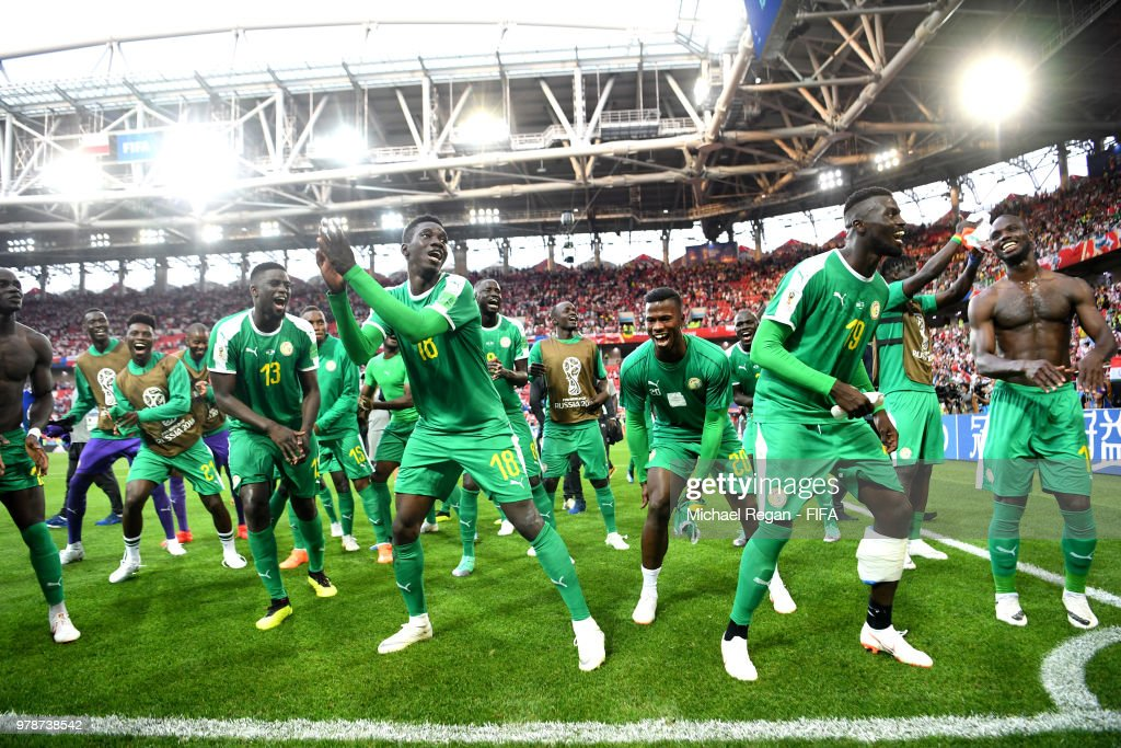Senegal players celebrate after their sides victory in the 2018 FIFA World Cup Russia group H match between Poland and Senegal at Spartak Stadium on June 19, 2018 in Moscow, Russia.