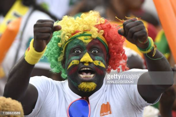 Senegal supporter cheers ahead of the 2019 Africa Cup of Nations Final football match between Senegal and Algeria at the Cairo International Stadium...