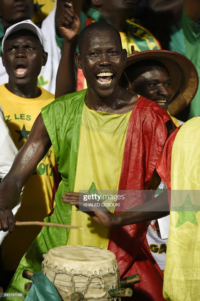 A Senegal supporter cheers during the 2017 Africa Cup of Nations group B football match between Tunisia and Senegal in Franceville on January 15, 2017. / AFP / KHALED