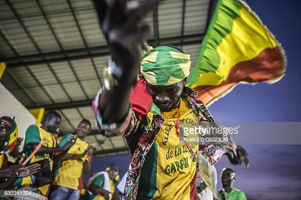Senegal supporter cheers for his team a training session in Bongoville on January 20 during the 2017 Africa Cup of Nations football tournament in...