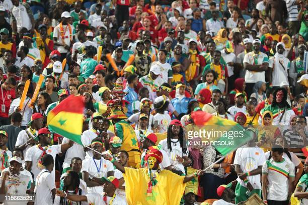 Senegal supporters cheer ahead of the 2019 Africa Cup of Nations Final football match between Senegal and Algeria at the Cairo International Stadium...