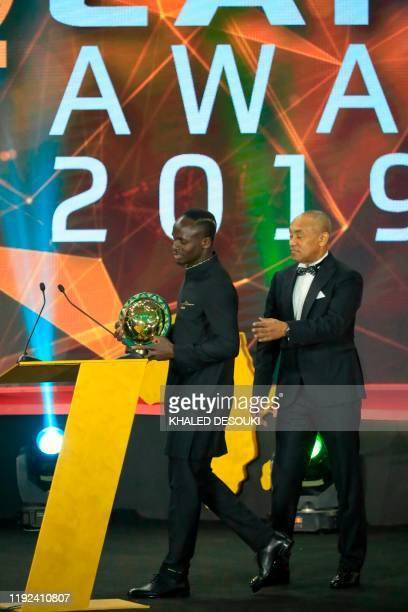 Senegal winger Sadio Mane receives the award for Player of the Year from Ahmad Ahmad President of the Confederation of African Football during the...