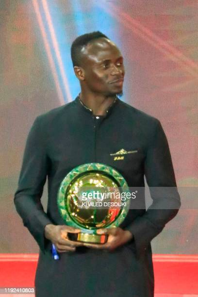Senegal winger Sadio Mane smiles after winning the Player of the Year award during the 2019 CAF Awards in the Egyptian resort town of Hurghada on...