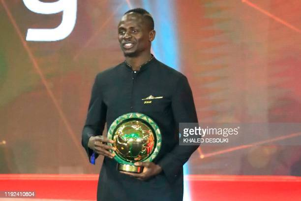 TOPSHOT Senegal winger Sadio Mane smiles after winning the Player of the Year award during the 2019 CAF Awards in the Egyptian resort town of...