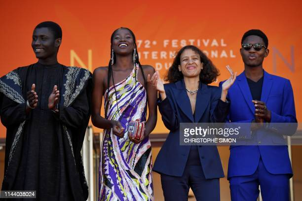 Senegalese actor Amadou Mbow Senegalese actress Mama Sane French actress and film director Mati Diop and Senegalese actor Ibrahima Traore pose as...