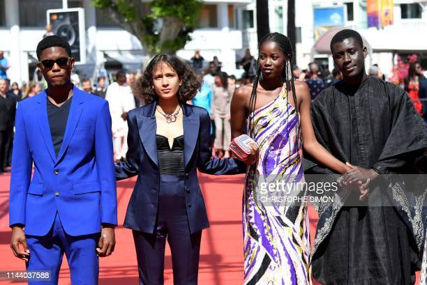 Senegalese actor Ibrahima Traore French actress and film director Mati Diop Senegalese actress Mama Sane and Senegalese actor Amadou Mbow arrive for...