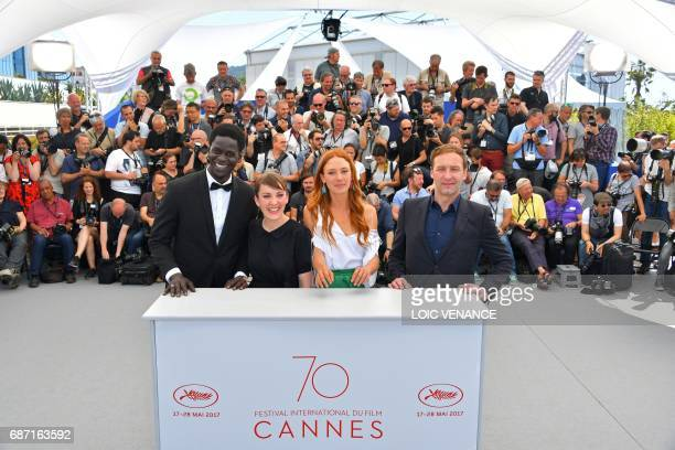 Senegalese actor Souleymane Seye Ndiaye French director Leonor Serraille French actress Lætitia Dosch and French actor Gregoire Monsaingeon pose on...