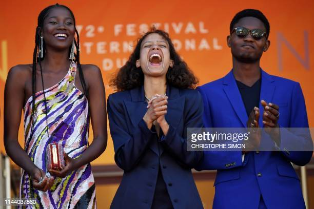 TOPSHOT Senegalese actress Mama Sane French actress and film director Mati Diop and Senegalese actor Ibrahima Traore pose as they arrive for the...
