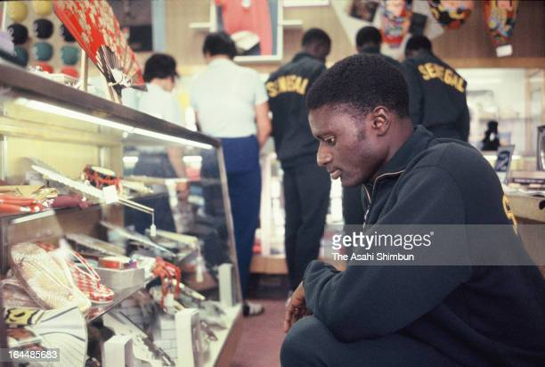 A Senegalese athlete looks at Japanese souvenirs at the Athletes Village ahead of Tokyo Olympic on October 1 1964 in Tokyo Japan