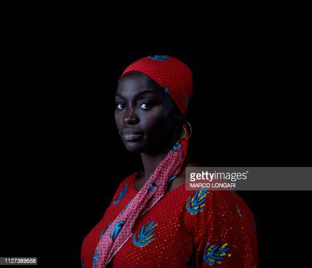 TOPSHOT Senegalese born French actress Aissa Maiga poses for a portrait in Ouagadougou on February 25 2019 during the 2019 edition of the FESPACO...