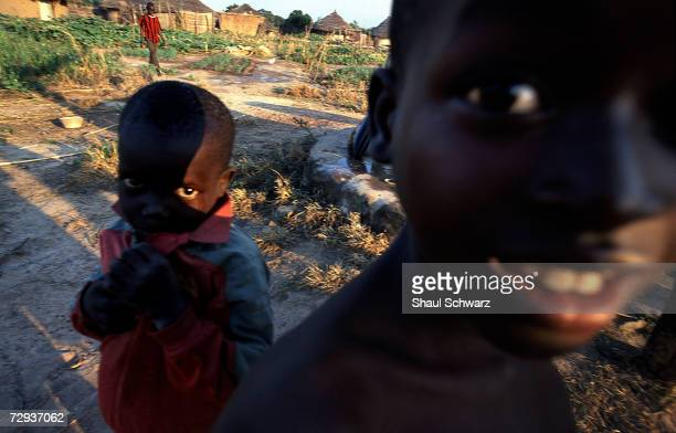 Senegalese children play outside in their village of Dialakoto Senegal August 23 2001 In Senegal rural communities including Dialakoto home to about...