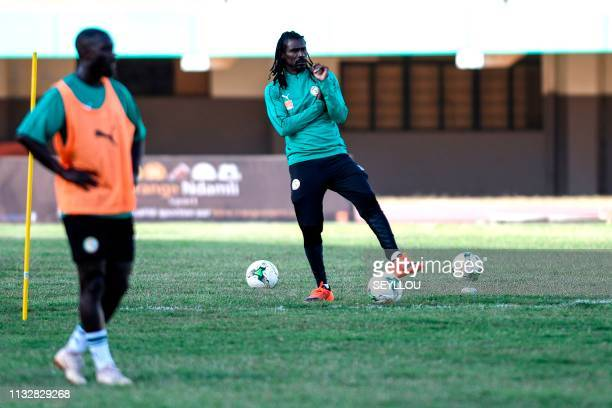 Senegalese coach Aliou Cisse stands on the field during a training session of the Senegal national football team on the eve of their friendly match...