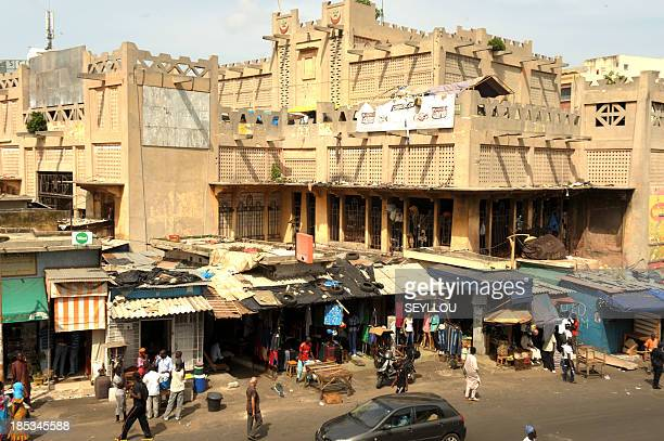 Senegalese congregate around the wellknown Sandaga market in Dakar on October 19 2013 The market will be closed today for an indefinite period due to...