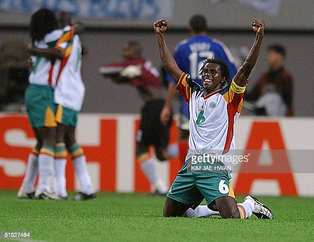 Senegalese defender Aliou Cisse celebrates at the end of his team's win over France in the opening match of 2002 FIFA World Cup Korea/Japan in Seoul...