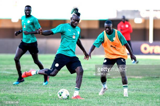 Senegalese defender Youssouf Sabaly shoots the ball next to Senegal's forward Mbaye Diagne during a training session of the Senegal national football...