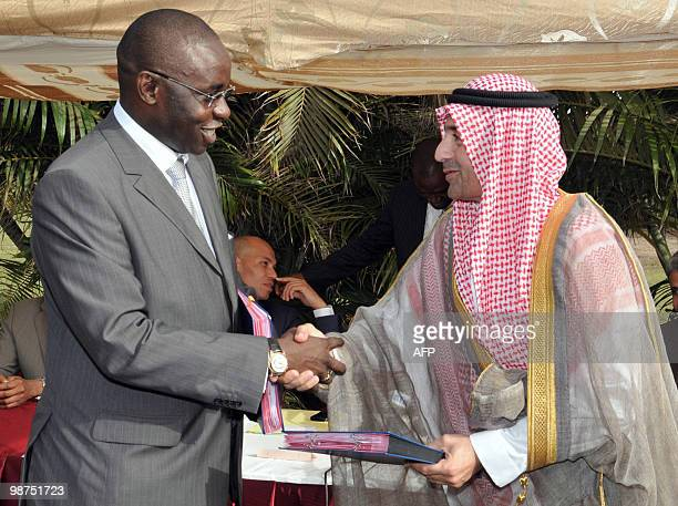 Senegalese Energy Minister Samuel Sarr shakes hands with Cheikh Saad Mohamed ben Laden vicepresident of Pcmc a subsidiary of Saudi Binladin group...