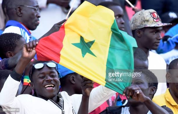 Senegalese fans cheer during their team last training session at the Leopold Sedar Senghor stadium in Dakar in Senegal on May 25 before travelling to...