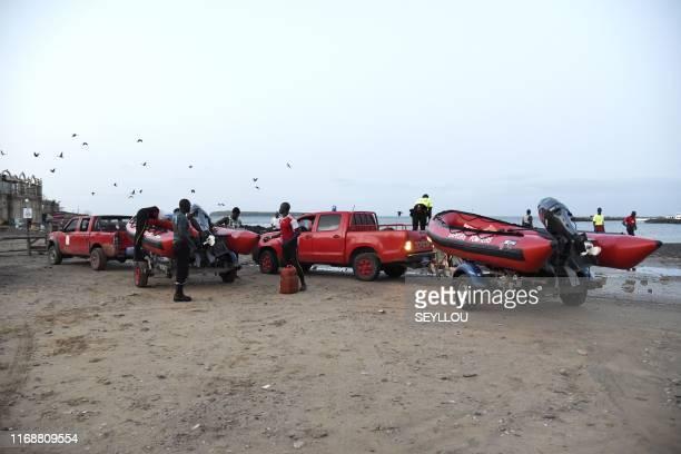Senegalese firefighters arrive on the beach of Dakar on September 17 2019 after a tourist boat capsized off La Madeleine island causing the death of...