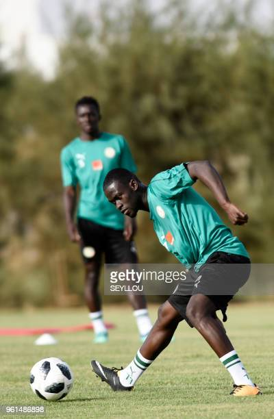 Senegalese footballer Pape Alioune Ndiaye takes part in a training session at The Diambars Training Camp at Saly some 50kms south of Dakar on May 22...