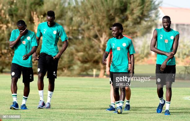 Senegalese footballers Salif Sane Isdrissa Gana Gueye and Cheikhou Kouyate take part in a training session at The Diambars Training Camp at Saly some...