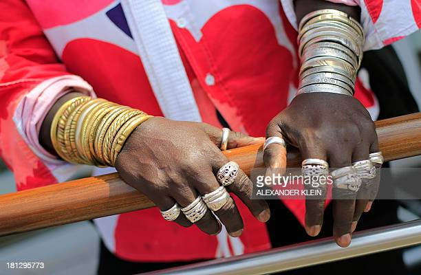 Senegalese jewelry designer 'Moko' and Formula 1 enthusiast poses on September 7 2013 in the paddock of the Circuit of Monza during the Formula One...