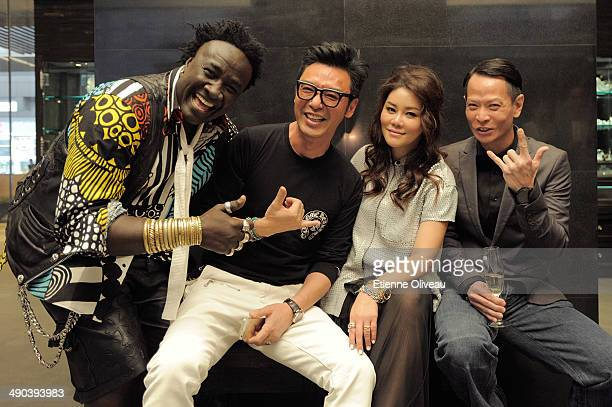 Senegalese jewelry designer 'Moko', Hong Kong musician Kenny Bee, a guest and Hong kong actor Ng Yuk Sau are posing for picture during the Chrome...