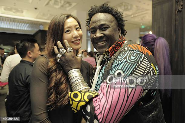 Senegalese jewelry designer 'Moko' posing with a guest during the Chrome Hearts Beijing Store Opening on May 14 2014 in Beijing China