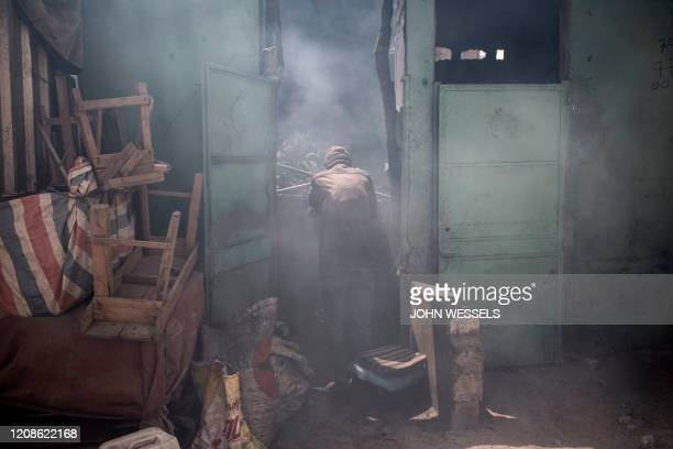Senegalese man tries to hide himself from the disinfectant after another of Dakar's markets was closed down cleaned and disinfected on March 30 2020...