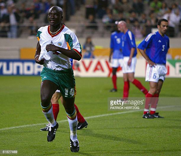 Senegalese midfielder Pape Bouba Diop celebrates after scoring the first goal of the 2002 FIFA World Cup Korea/Japan in Seoul, 31 May 2002. Senegal...